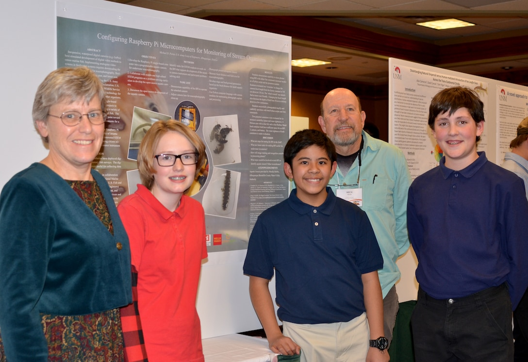 Mesa Del Sol students with their poster, at the 52nd Joint Annual Meeting of the Arizona and New Mexico Chapters of the Wildlife Society and American Fisheries Society, held Feb. 7, 2019, in Albuquerque, N.M. (l-r): Mary Fox, science teacher; Addison Epps, student; Kyle Llonoso, student; Michael Porter, fishery biologist; and Logan Guerrero, student.