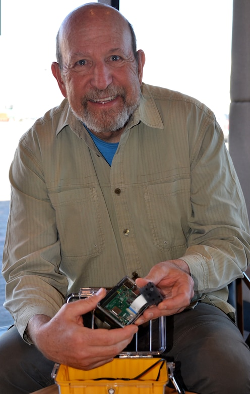 Michael Porter, fishery biologist, holds one of the Raspberry Pi computers being utilized by students at Mesa Del Sol Middle School.