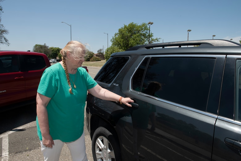 Heide Couch, 60th Air Mobility Wing photographer, prepares to enter a vehicle May 30, 2019 at Travis Air Force Base, California. Before entering a vehicle driven by a ride-share driver, passengers should confirm the driver's identity and ensure they are entering the correct vehicle. (U.S. Air Force photo by Tech. Sgt. James Hodgman)