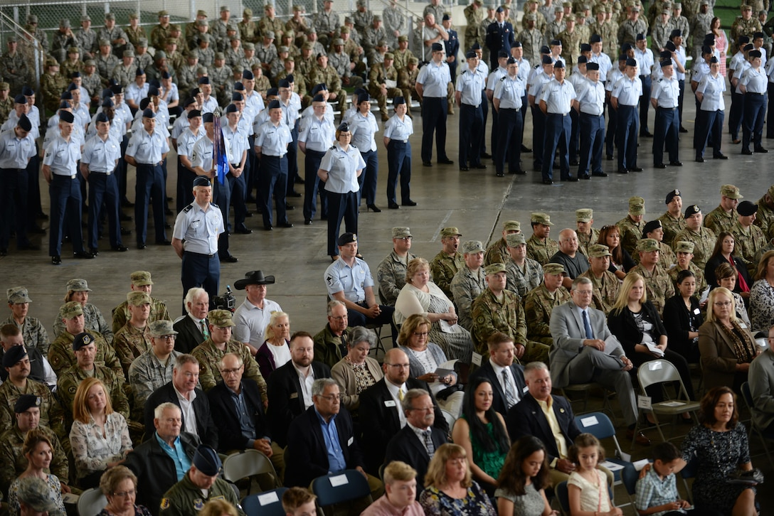 Airmen from across the 28th Bomb Wing stand in formation at the change of command ceremony held at the PRIDE Hangar on Ellsworth Air Force Base, S.D., May 30, 2019. The ceremony is a time-honored military tradition that serves as representation of the exchange of responsibility and authority from one commander to another. (U.S Air Force photo by Master Sgt. Kenya Shiloh)
