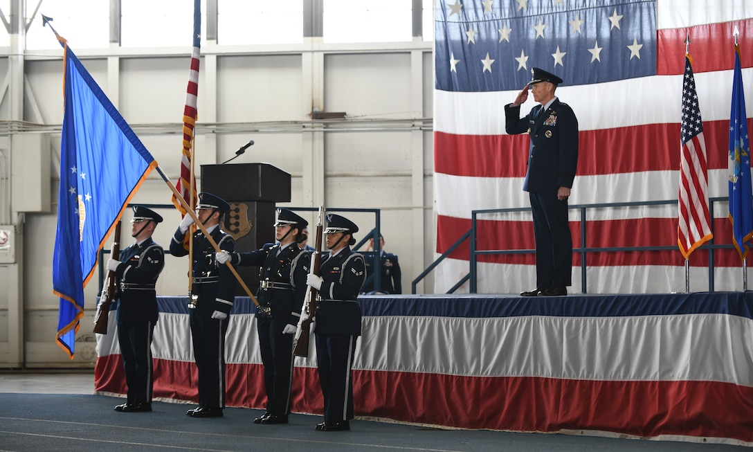 Maj. Gen. James Dawkins Jr., the 8th Air Force commander, salutes as the Honor Guard presents the colors, during a change of command ceremony at Ellsworth Air Force Base, S.D., May 30, 2019. The ceremony is a time-honored military tradition that serves as representation of the exchange of responsibility and authority from one commander to another. (U.S. Air Force photo by Airman 1st Class Christina Bennett)