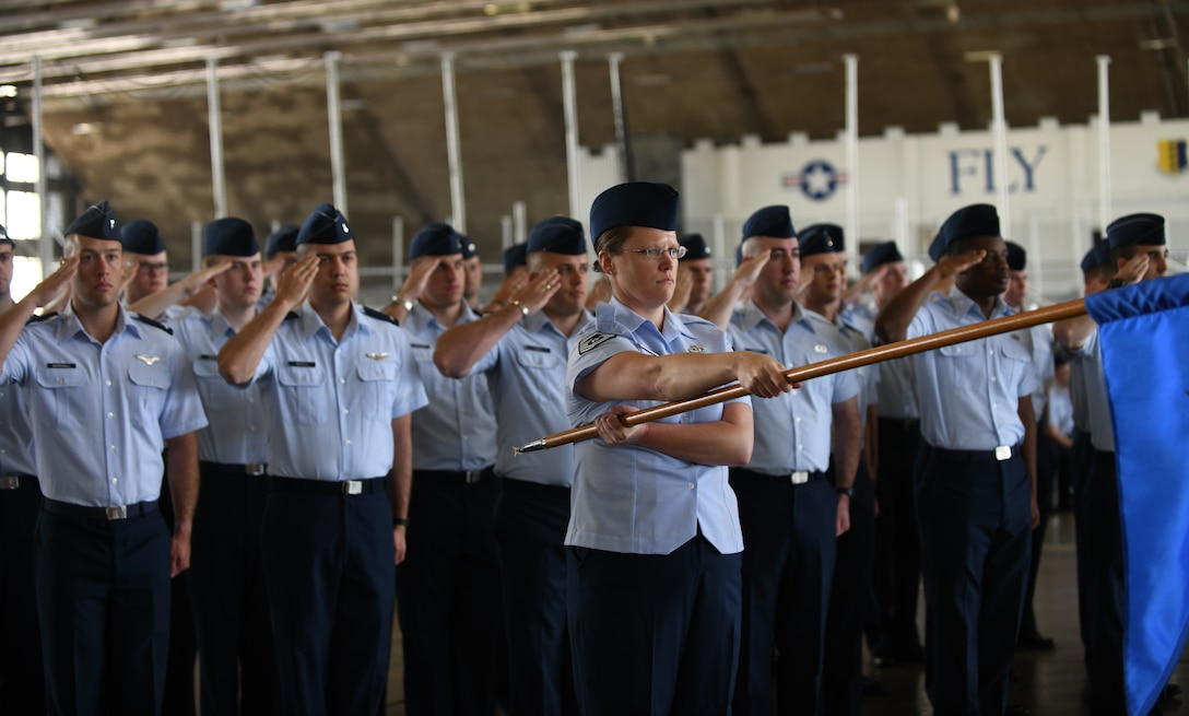 A formation of Airmen from the 28th Operations Group render a salute during a change of command ceremony at Ellsworth Air Force Base, S.D., May 30, 2019. The ceremony is a time-honored military tradition that serves as representation of the exchange of responsibility and authority from one commander to another. (U.S. Air Force photo by Airman 1st Class Christina Bennett)