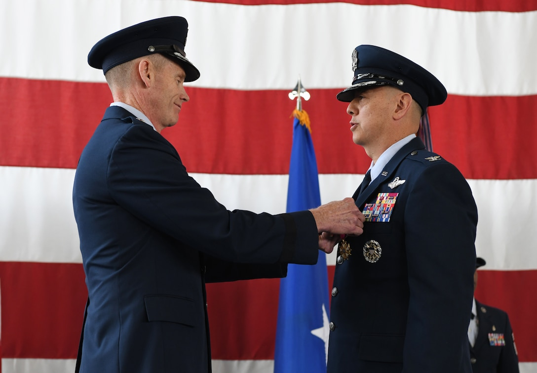 Col. John Edwards, the outgoing 28th Bomb Wing commander, receives the Legion of Merit from Maj. Gen. James Dawkins Jr, the 8th Air Force commander, during a change of command ceremony at Ellsworth Air Force Base, S.D., May 30, 2019. Edward was awarded the medal for exceptionally meritorious conduct in the performance of outstanding service to the United States, as commander of the 28th BW. (U.S. Air Force photo by Senior Airman Thomas Karol)