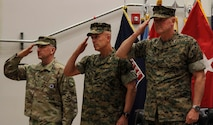 CAMP HUMPHREYS, Republic of Korea – Gen. Robert Abrams (left), commander of United States Forces Korea, Maj. Gen. Patrick J. Hermesmann (center), former commander of U.S. Marine Corps Forces Korea, and Maj. Gen. Bradley S. James (right), commander of Marine Forces Korea, salute for colors during a change of command ceremony here, 30 May. Hermesmann relinquished command to James after leading Marines on the Korean peninsula for more than a year while building upon the ROK and U.S. Alliance. Additional photos can be seen on the MARFORK webpage on DVIDS at the following address: https://www.dvidshub.net/unit/MARFORK(Official U.S. Marine Corps photo by Sgt. Nathaniel Hanscom/Released)