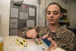Staff Sgt. Victoria Keyes, the outgoing 379th Expeditionary Medical Group (EMDG) pharmacy services NCO in charge, counts pills at the clinic Jan. 15, 2019, at Al Udeid Air Base, Qatar. The National Contracts team celebrated surpassing $1 billion in avoided costs for Department of Defense customers purchasing generic pharmaceutical drugs for the first time in its six-year history. (U.S. Air Force photo by Tech. Sgt. Christopher Hubenthal)