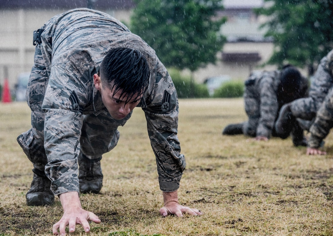 Senior Airman Shain Chairez, 374th Security Forces Squadron response force leader, performs a bear crawl during a Police Week Defenders Challenge at Yokota Air Base, Japan, May 21, 2019.