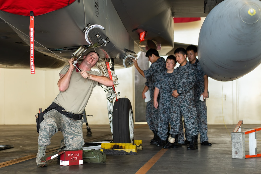 U.S. Air Force Senior Airman Jacob Johnson, 18th Maintenance Group weapons lead crew member, prepares an F-15D Eagle for weapons during the first bilateral weapons load exchange between Kadena Air Base and the Japan Air Self-Defense Force, May 23, 2019. The goal of the training is to accurately and safely load munitions while strengthening the U.S.-Japan alliance in order to secure a free-and-open Indo-Pacific. (U.S. Air Force photo by Airman 1st Class Matthew Seefeldt)