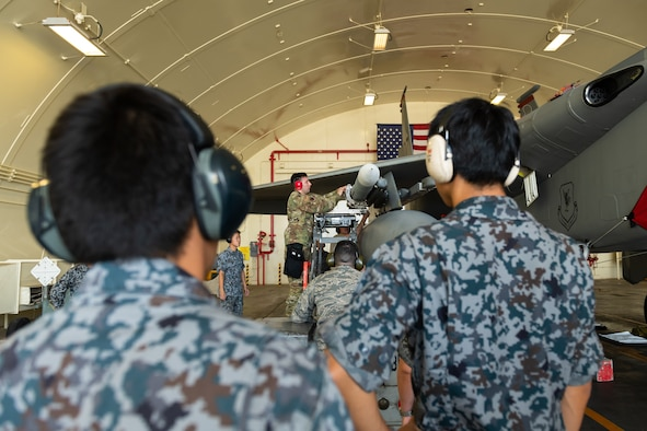 Japan Air Self-Defense Force members watch a load demonstration during the first bilateral weapons load exchange between Kadena Air Base and the JASDF, May 23, 2019. The goal of the training is to accurately and safely load munitions while strengthening the U.S.-Japan alliance in order to secure a free-and-open Indo-Pacific. (U.S. Air Force photo by Airman 1st Class Matthew Seefeldt)
