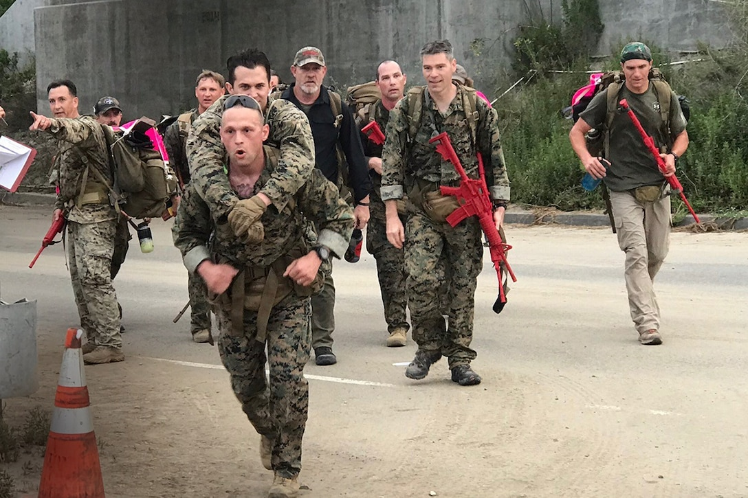 MCSC Marines carry double amputee during Recon Challenge