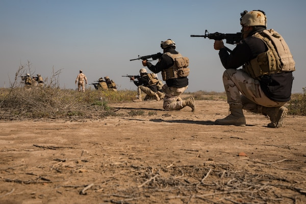An Iraqi instructor from the School of Infantry NCO2 (SINCO2) conducts an exercise with Iraqi army soldiers in which they conduct proper patrol formations, section attacks, and support by fire actions at Camp Taji, Iraq, Mar. 05, 2019. The soldiers are under the supervision of Iraqi instructors from SINCO2 with oversight from Australian army trainers from Task Group Taji 8. Task Group Taji 8 is a combined Australian-New Zealand Task Group that provides the Iraqi Security Forces with training to help stabilize areas cleared of Daesh. The Iraqi Army School of Infantry NCO 2 recently achieved initial operating capability, meaning that the school can perform 75 percent of its operations without Coalition assistance.