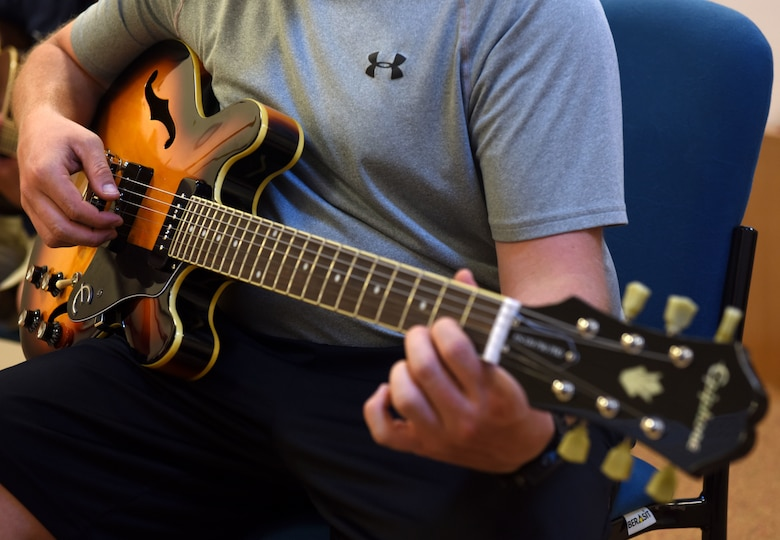 Tech. Sgt. David Eash, 39th Security Forces Squadron flight sergeant, plays a guitar during a guitar class held May 29, 2019, at Incirlik Air Base, Turkey. The base offers a variety of classes for Airmen interested in learning a new hobby such as guitar, cooking, painting and dance classes. (U.S. Air Force photo by Staff Sgt. Trevor Rhynes)
