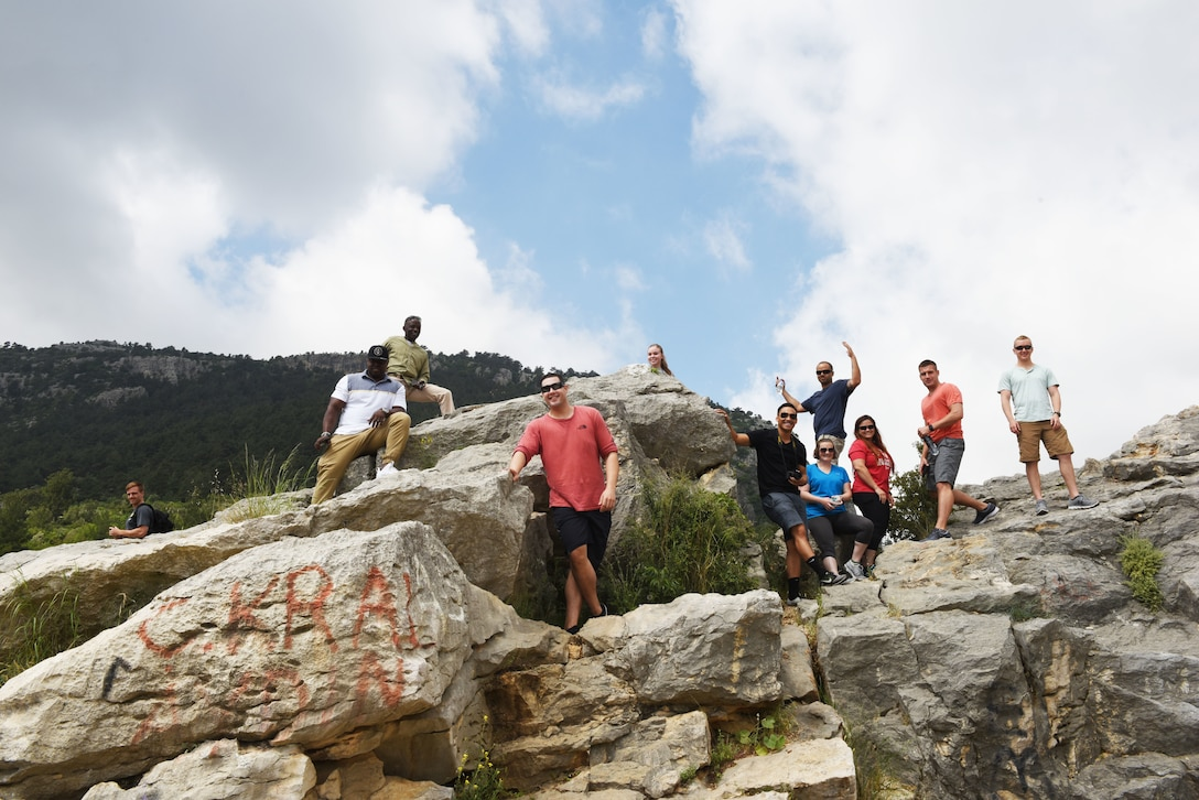 Airmen assigned to Incirlik Air Base climb on a rock formation next to the Varda Bridge during an outdoor recreation trip on May 25, 2019, in Adana, Turkey. This was one of several outdoor recreation trips the 39th Force Support Squadron organized for Airmen to enjoy the local area while learning about Turkish culture. (U.S. Air Force photo by Senior Airman Joshua Magbanua)