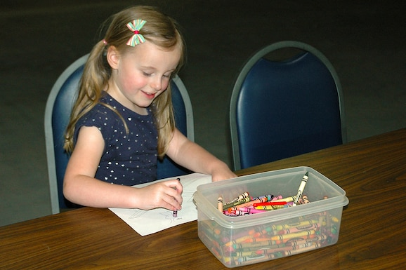 Young girl coloring during Family Day on May 18, 2019, at the National Museum of the U.S. Air Force. (U.S. Air Force photo)