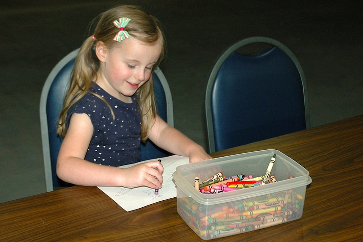Picture of young girl coloring with crayons