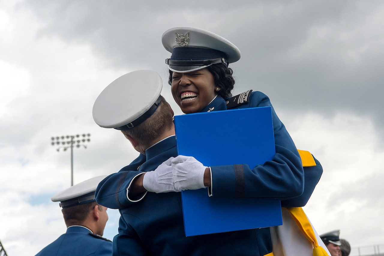 Air Force Academy graduates celebrate.