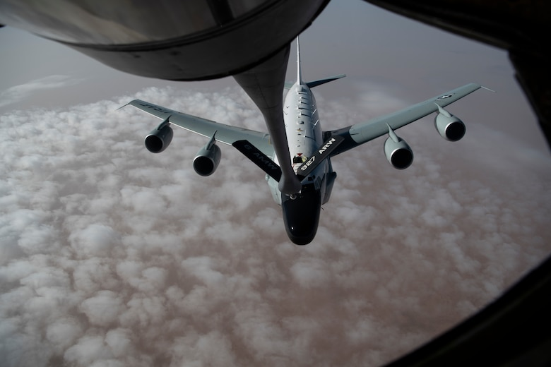 A RC-135 Rivet Joint receives fuel from a KC-135 Stratotanker