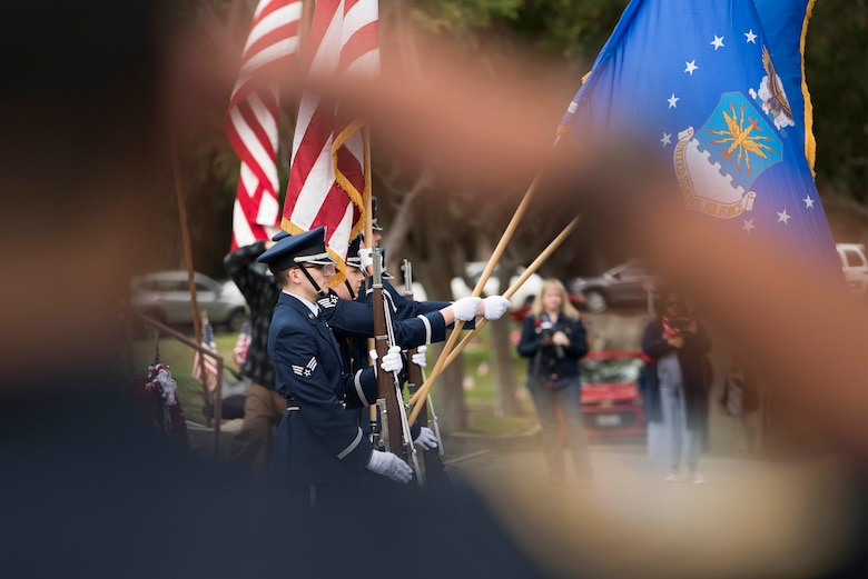 Members of the Vandenberg Air Force Base Honor Guard post the colors