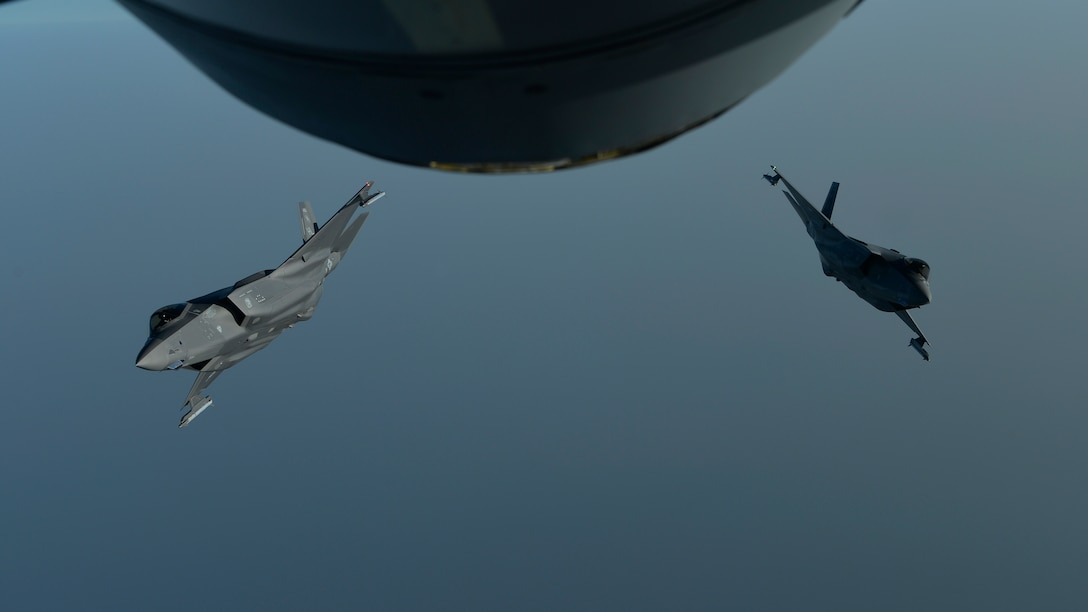 Two Air Force F-35A Lightning IIs break away from each other after an aerial refueling mission