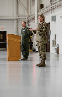 Chief Master Sgt. Kathleen McCool, 509th Bomb Wing command chief, introduced herself to an audience during a commander's call assembly on May 23, 2019, at Whiteman Air Force Base, Missouri. McCool and Col. Jeffrey Schreiner, the 509th BW commander, took the opportunity to emphasize the importance of Airman wellness. (U.S. Air Force photo by Staff Sgt. Kayla White)