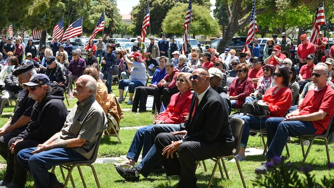 Community members gather for a Memorial Day ceremony May 27, 2019, at the Santa Maria Cemetery, Calif. Throughout the ceremony, service members and veterans who served in times of war were asked to stand as a way to show them appreciation for their sacrifice. (U.S. Air Force photo by Airman 1st Class Aubree Milks)