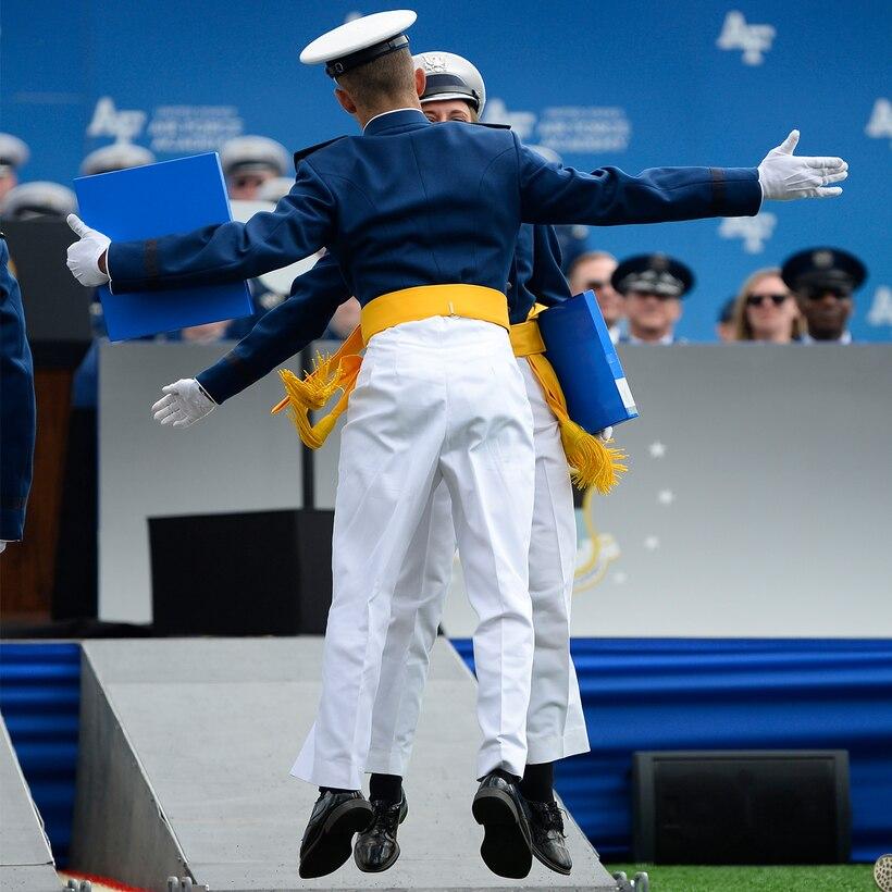 U.S. Air Force Academy graduates celebrate after receiving their diplomas.