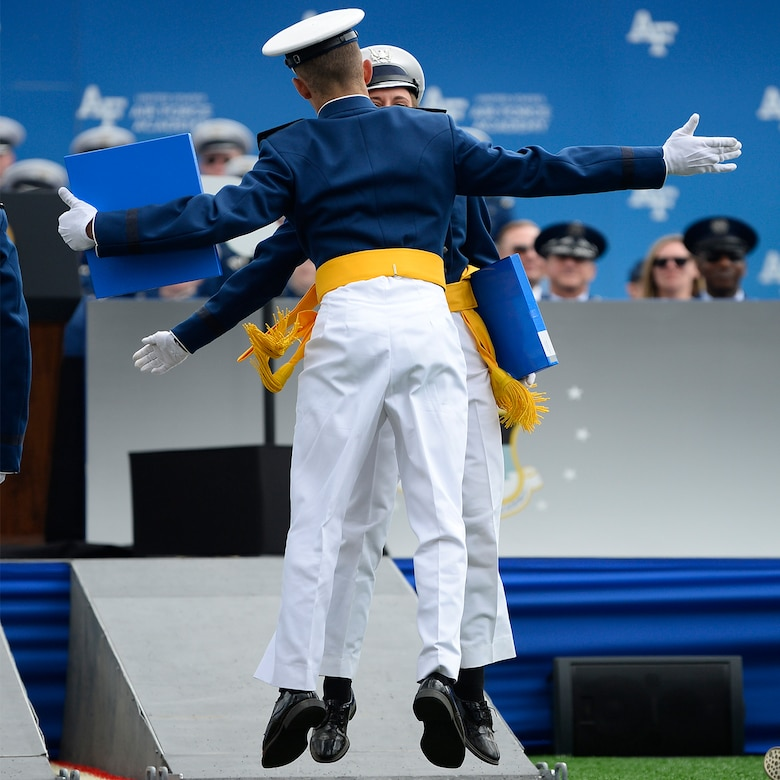 U.S. Air Force Academy graduates celebrate after receiving their diplomas.