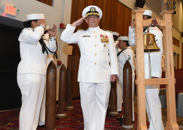 (May 30, 2019) SANTA RITA, Guam - Capt. Todd Gorman salute the side boys during the USS Antietam change of command ceremony at the big screen theater at U.S. Naval Base Guam.  Capt. Todd Gorman relieved Capt. George A. Kessler as the ship's Commanding Officer of the Ticonderoga-class guided missile cruiser. Antietam is forward deployed to the U.S. 7th Fleet area of operation in support of security and stability in the Indo-Pacific region.