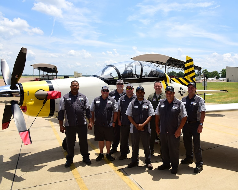 The 37th Flying Training Squadron's new flagship T-6 Texan II is showcased alongside the maintainers who painted it May 30, 2019, on Columbus Air Force Base. Members of the 37th FTS took inspiration for their design from their history to celebrate their past, present and future. (U.S. Air Force photo by Elizabeth Owens)