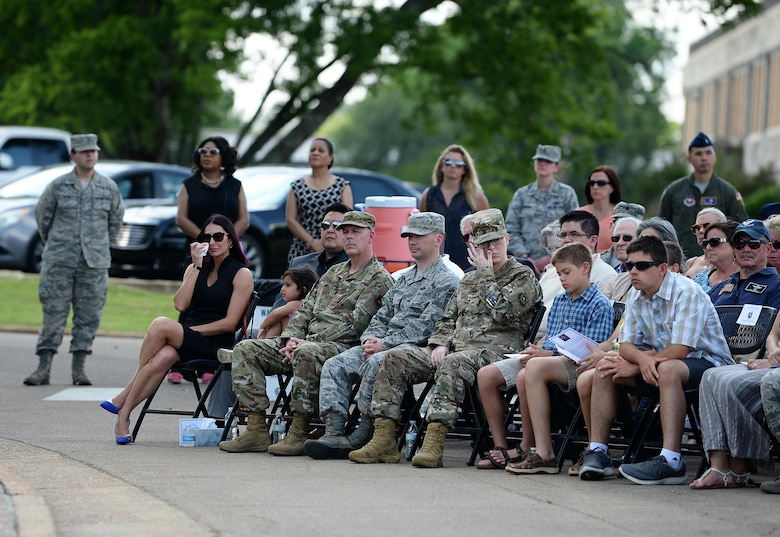 """Attendees pay tribute to Master Sgt. John Chapman, Medal of Honor recipient, and 1st Lt. David Albandoz, Specialized Undergraduate Pilot Training  Class 17-14 graduate, in front of the Richard """"Gene"""" Smith Plaza during a Memorial Day ceremony May 28, 2019, on Columbus Air Force Base, Miss. The Memorial Day ceremony honored the nation's fallen Airmen, Soldiers, Sailors and Marines, and included a special memorial service for Chapman and Albandoz. (U.S. Air Force photo by Airman 1st Class Hannah Bean)"""
