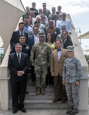 502nd Air Base Wing Honorary Commanders and their respective commanders stop to take a photo after lunch at the Slagel dining facility at Joint Base San Antonio-Fort Sam Houston May 21
