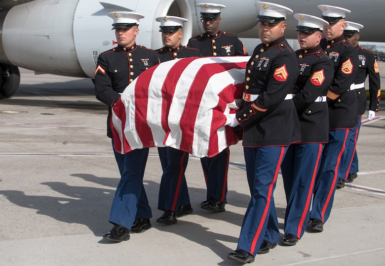 Marines assigned to the 6th Engineer Support Battalion, Bulk Fuel Company Charlie, Site Support Phoenix, carry a fallen Marine in a flag-draped transfer case during a dignified transfer May 17, 2019, at the Phoenix Sky Harbor International Airport, Ariz.