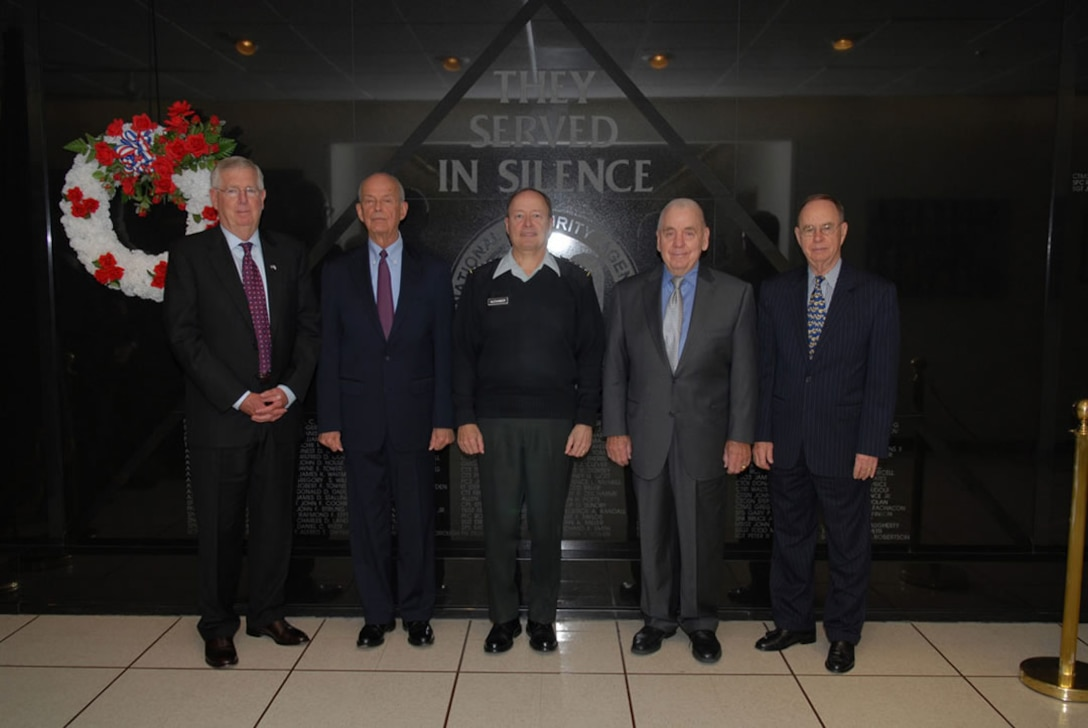 NSA Director GEN Keith B. Alexander, USA, with Former Directors and Deputy Directors in front of NSA's Memorial Wall
