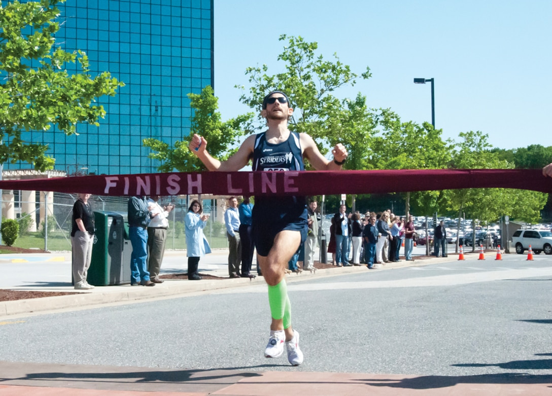 The First Athlete Crosses the Finish Line at the 2012 Armed Forces Week 5K Race