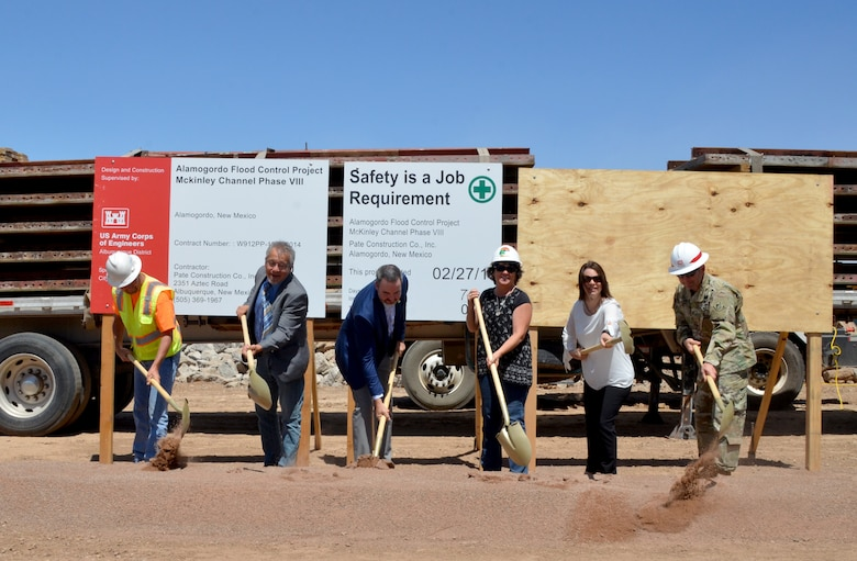 ALAMOGORDO, N.M. -- (l-r): Jeff Ridolpho, project manager, Pate Construction; Rene Romo, Sen. Udall's office; Alamogordo Mayor Pro-Tem Jason Baldwin; Nancy Belshaler, project manager, City of Alamogordo; Dara Parker, Senator Heinrich's office; and Lt. Col. Larry Caswell, Albuquerque District commander, officially break ground on the final phase of the Alamogordo McKinley Channel Flood Control Project, May 17, 2019.