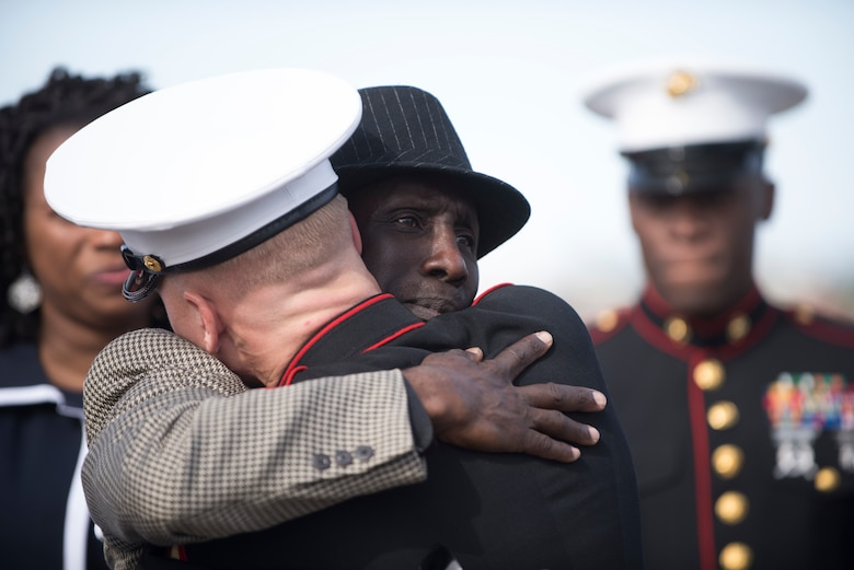 The father of a fallen Marine hugs Lance Cpl. Kyle Pierce, Alpha Company administrative specialist, Headquarters and support Battalion, Marine Corps Installations East, during a dignified transfer at the Phoenix Sky Harbor International Airport in Phoenix May 17, 2019.