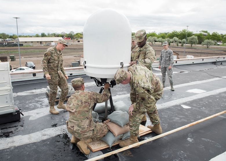 Mountain Home Air Force Base and Hurlburt Field weather system personnel assemble a Doppler system May 25, 2019, at Mountain Home Air Force Base, Idaho. The is the first time the Doppler system has been installed on a Continental United States base. (U.S. Air Force photo by Senior Airman Tyrell Hall)