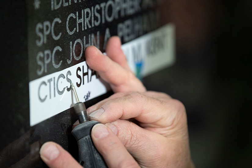 Photo of CTICS Kent's name being engraved on the National Cryptologic Memorial Wall