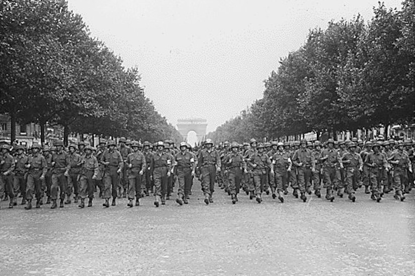 Soldiers march down the Champs-Elysees.