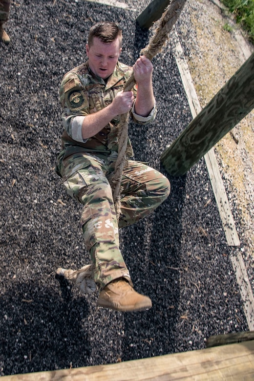 Senior Airman William McLaughlin, 502nd Security Forces Squadron combat arms instructor, competes in an obstacle course race during Police Week May 14, 2019, at Joint Base San Antonio, Texas. National Police Week dates back to 1962, when President John F. Kennedy proclaimed May 15 as National Peace Officers Memorial Day. That same year, Congress established by joint resolution the week in which May 15 falls as National Police Week.
