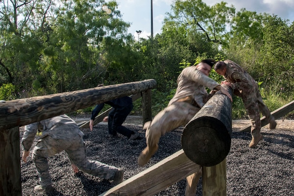 Joint Base San Antonio security forces members compete in an obstacle course race during Police Week May 14, 2019, at Joint Base San Antonio, Texas. National Police Week dates back to 1962, when President John F. Kennedy proclaimed May 15 as National Peace Officers Memorial Day. That same year, Congress established by joint resolution the week in which May 15 falls as National Police Week.