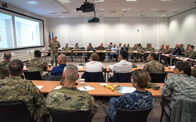 Attendees listen to a brief on the upcoming changes to the military health system during day one of the 2019 U.S. Africa Command Surgeon Synchronization Conference in Stuttgart, Germany, May 28, 2019. The conference brought together medical professionals from across the command, and interagency and foreign partners, to enable collaboration and to discuss areas of concern within the medical enterprise in Africa. (U.S. Navy photo by Mass Communication Specialist 1st Class Christopher Hurd)