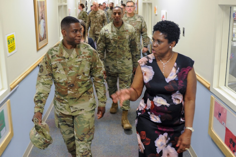 Vivian Gadson, 628th Force Support Squadron flight chief of fleet and family services, explains the expansions and renovations to the child development center to Col. Terrence Adams, 628th Air Base Wing commander, after a ribbon cutting ceremony May 31, 2019, at the Joint Base Charleston Air Base, S.C.