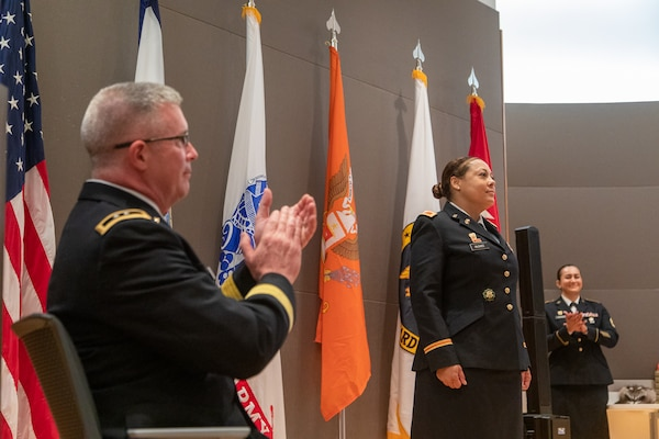 Col. Kim McGhee (center) is applauded by Maj. Gen. James Hoyer, Adjutant General of the West Virginia National Guard, during a formal promotion ceremony held May 20, 2019, at the Army National Guard Readiness Center in Arlington, Virginia. McGhee is the first African-American female to be promoted to the rank of colonel in the West Virginia Army National Guard. (Courtesy photo)