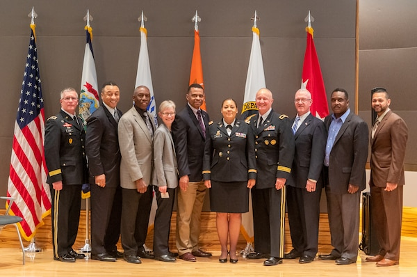 Col. Kim McGhee, center, poses for a photo with family, friends and colleagues following her promotion to O-6 May 20, 2019, at the Army National Guard Readiness Center in Arlington, Virginia. McGhee is the first African-American female to be promoted to the rank of colonel in the West Virginia Army National Guard. (Courtesy photo)