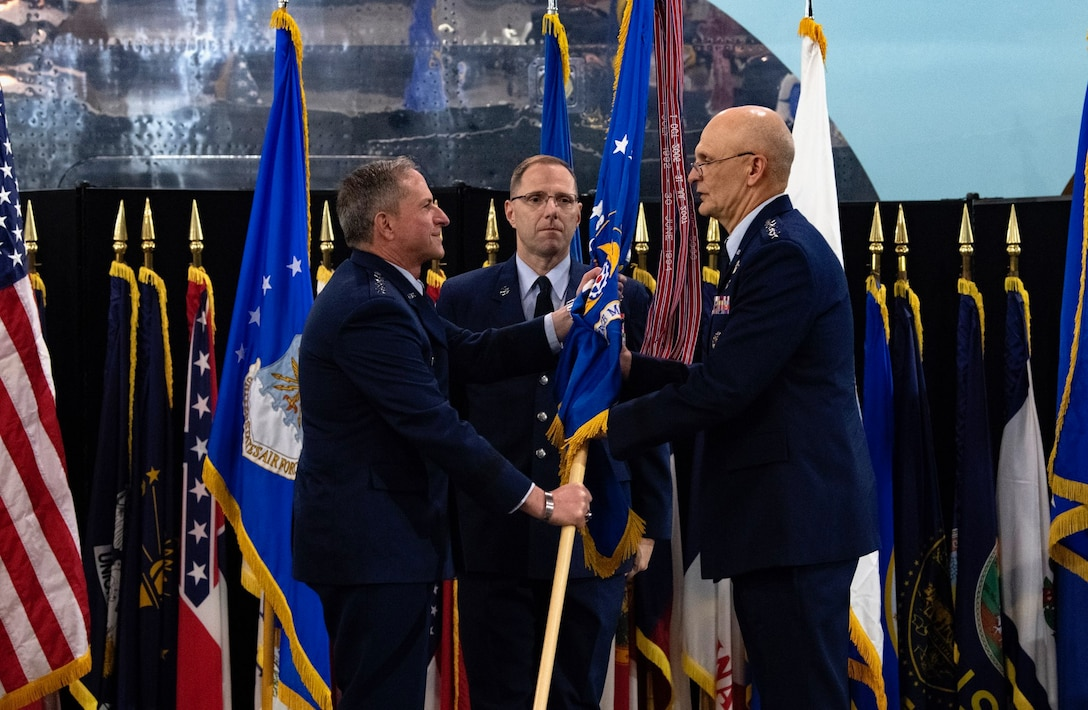 Air Force Chief of Staff Gen. David L. Goldfein passes the flag to Gen. Arnold W. Bunch, Jr. as Bunch assumes command of Air Force Materiel Command during a ceremony at the National Museum of the United States Air Force, Wright-Patterson Air Force Base, Ohio, May 31, 2019. Bunch takes command of Air Force Materiel Command after serving as the Deputy to the Assistant Secretary of the Air Force for Acquisition, Technology, and Logistics at the Pentagon. (U.S. Air Force photo/Scott M. Ash)