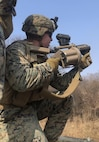 Lance Corporal Rosenberryof 2nd Platoon, Company C, 1st Battalion, 4th Marines fires the M32 Grenade Launcher during Dragon Viper 19.1 at Story Live Fire Complex in South Korea, February 21 2019.