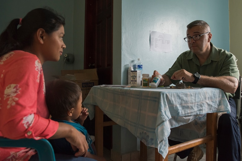 U.S. Army Maj. Jorge Chavez, Joint Task Force – Bravo Medical Element public health nurse, speaks with a patient about preventive medicine during a Pediatric Medical Readiness Training Exercise May 23, 2019 in La Paz, Honduras. MEDRET missions allow JTF-B medical personnel to train in their areas of expertise, while providing a service and strengthening partnership with the host nation. The service members saw approximately 120 patients during the mission. (U.S. Air Force photo by Staff Sgt. Eric Summers Jr.)