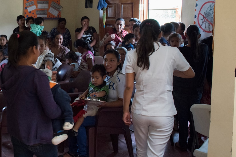 Mothers and their children wait to be seen by medics from Joint Task Force - Bravo during a Pediatric Medical Readiness Training Exercise May 23, 2019 in La Paz, Honduras. MEDRET missions allow JTF-B medical personnel to train in their areas of expertise, while providing a service and strengthening partnership with the host nation. The service members saw approximately 120 patients during the mission. (U.S. Air Force photo by Staff Sgt. Eric Summers Jr.)