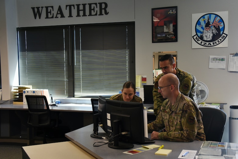 Capt. Gretchen De Blaey, 2nd Lt Kevin Smith and Master Sgt. Mark Bryson, 80th Operations Support Squadron Weather Flight
