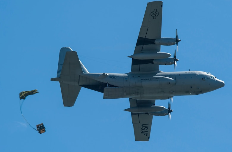 A C-130 Hercules transport aircraft from the Montana Air National Guard 120th Airlift Wing drops a Container Delivery System bundle on the flight line May 29, 2019, at Malmstrom Air Force Base, Mont.